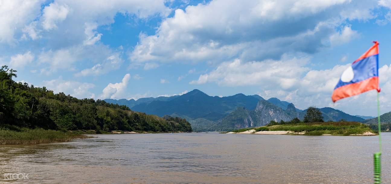 饱览龙坡邦的独特自然风光,翠绿的山景交织著湄公河