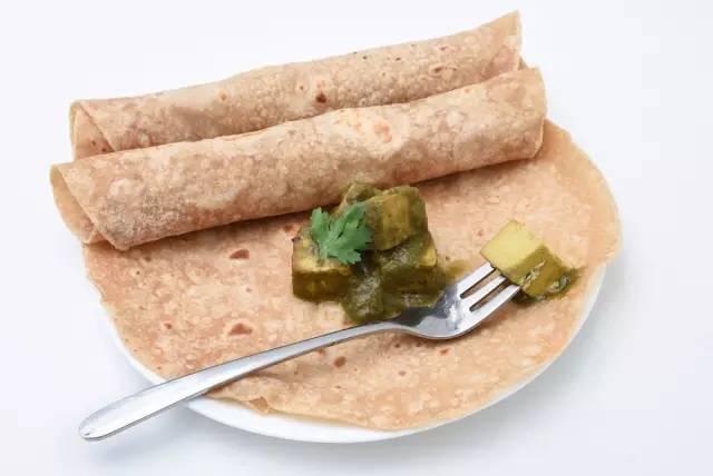 「Naan」 是 印 度 料 理 的 主 食 之 一 。