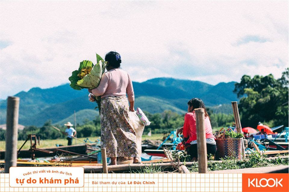 người dân bản địa ở phiên chợ trong chuyến du lịch inle