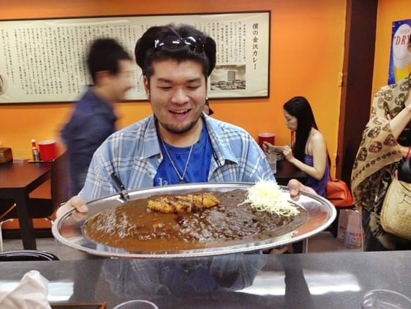 Man with giant japanese curry in Bangkok