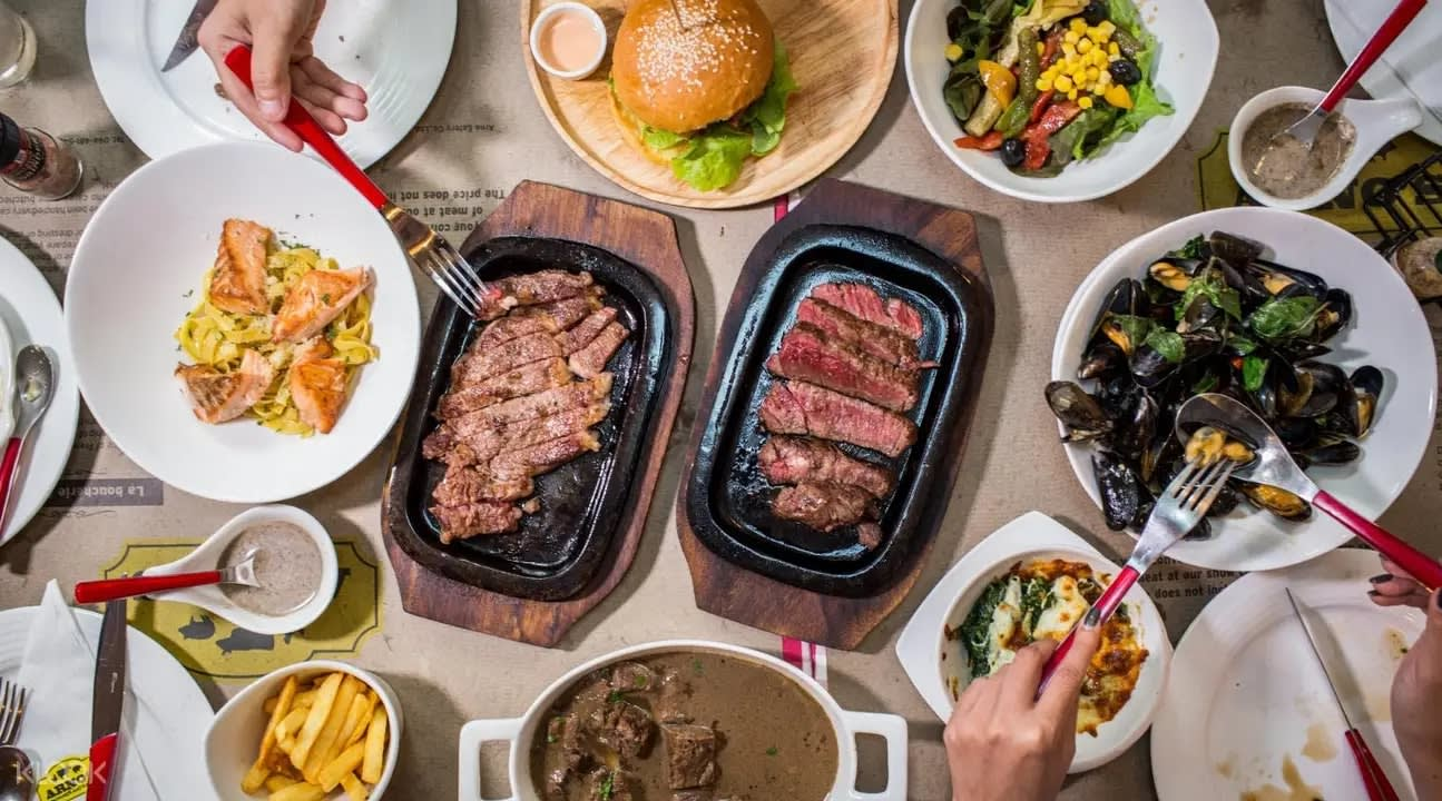Sizzling steaks at Arno's Suanplu