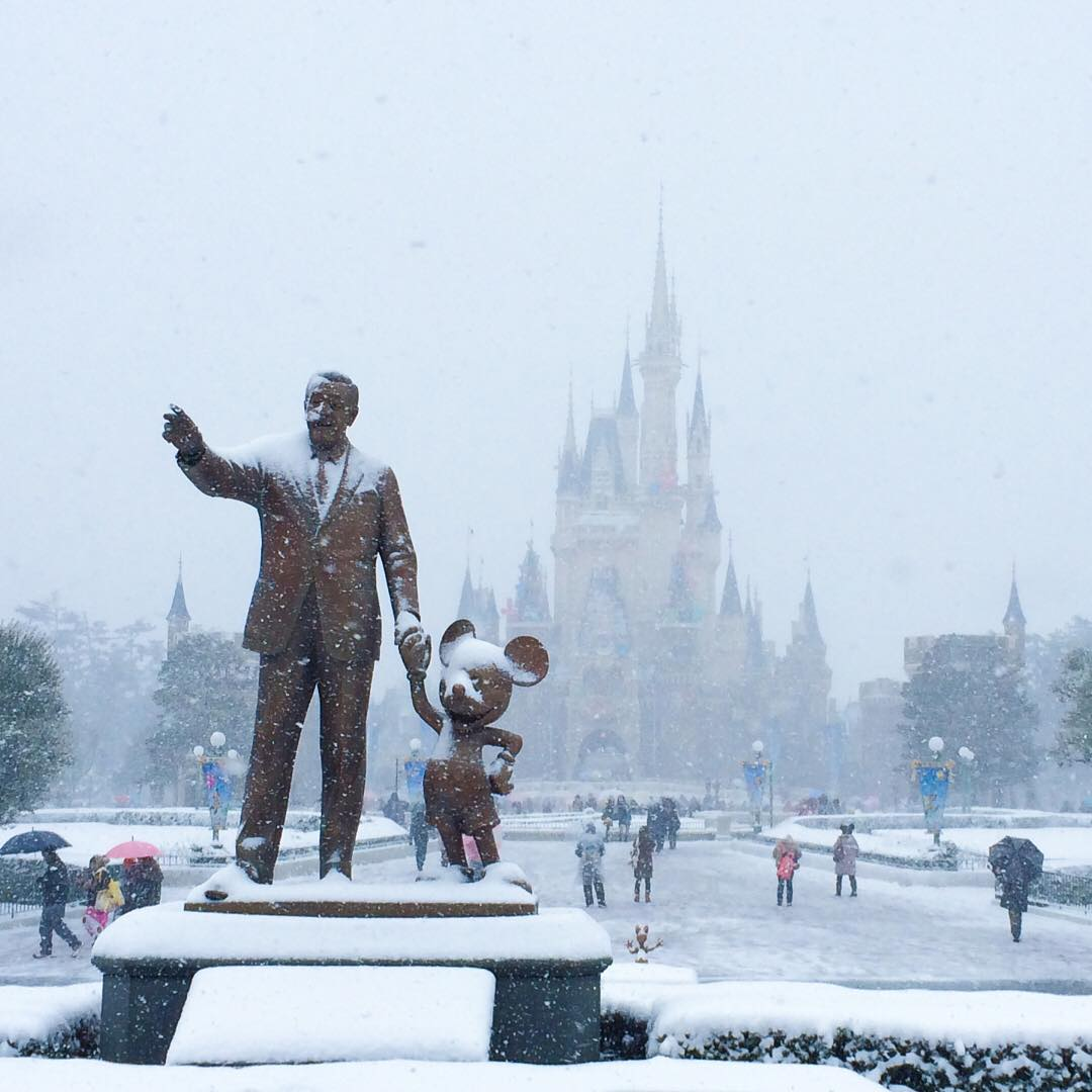 walt disney and mickey in snow