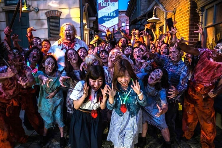Zombies overwhelming two visitors at Universal Studios Japan