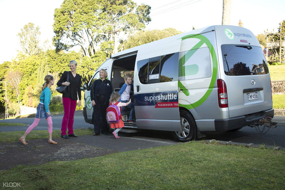 tourists board a van in new zealand