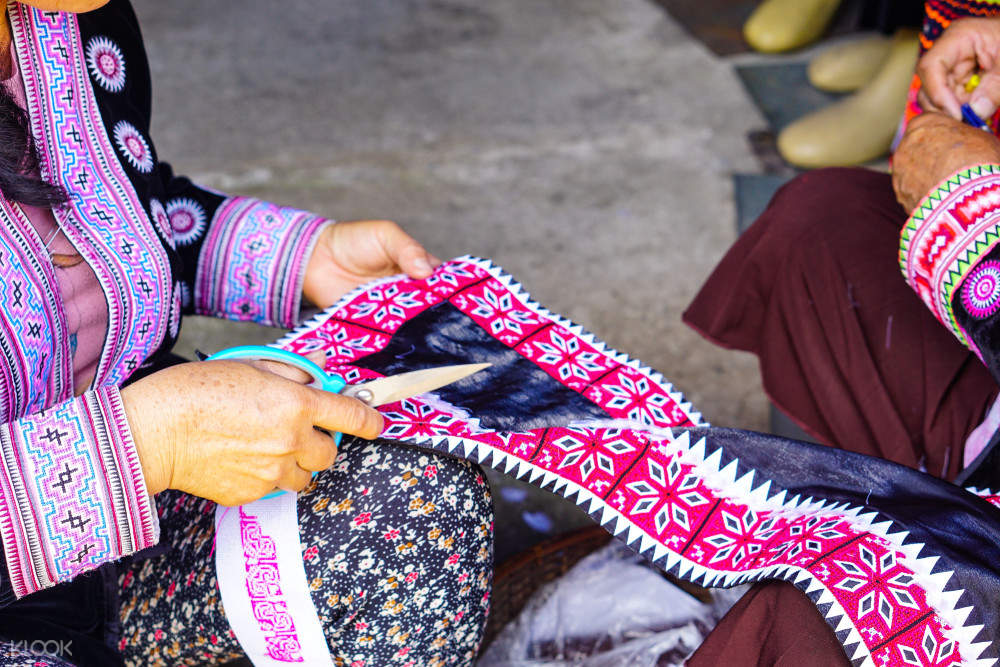 woman holding traditional textile in chiang mai