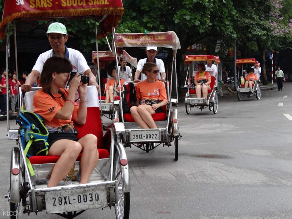 tourists in vietnam riding the cyclo
