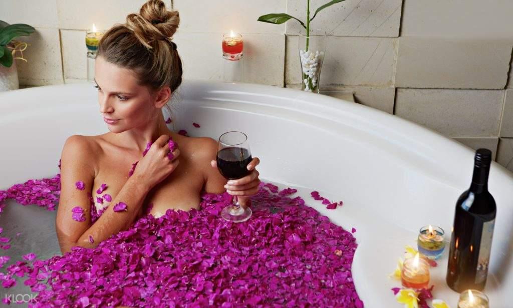 a woman in a flower bath