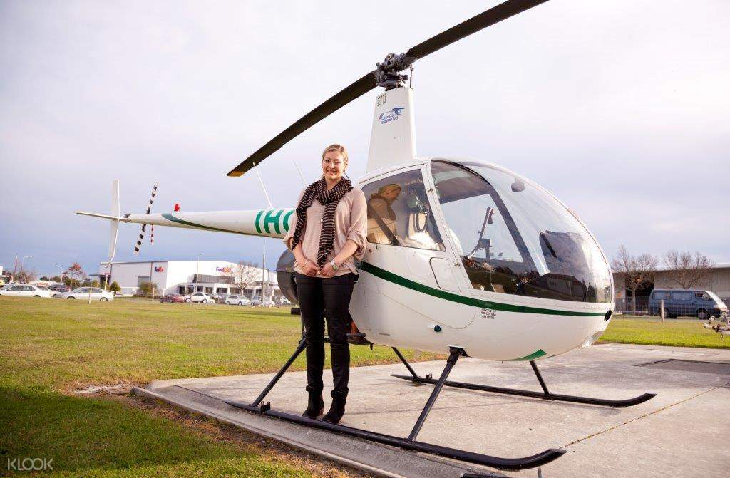 woman standing in front of a helicopter