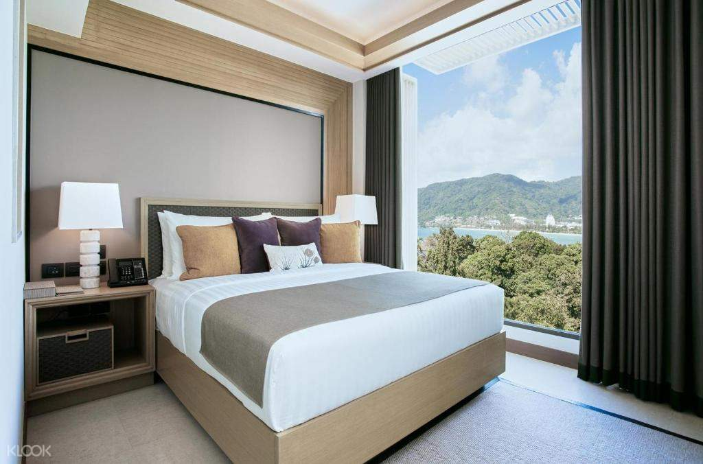a bedroom suite with a view of the ocean
