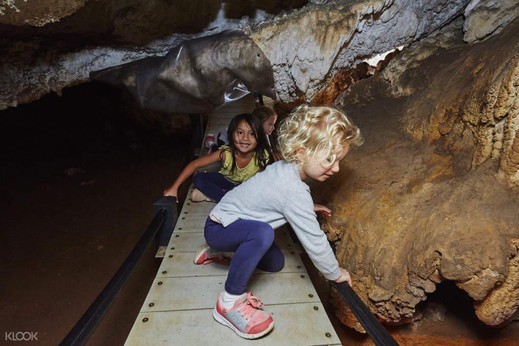 kids having fun exploring the cave