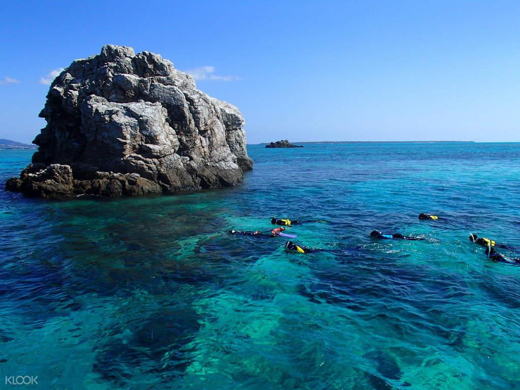 people snorkeling in phantom island
