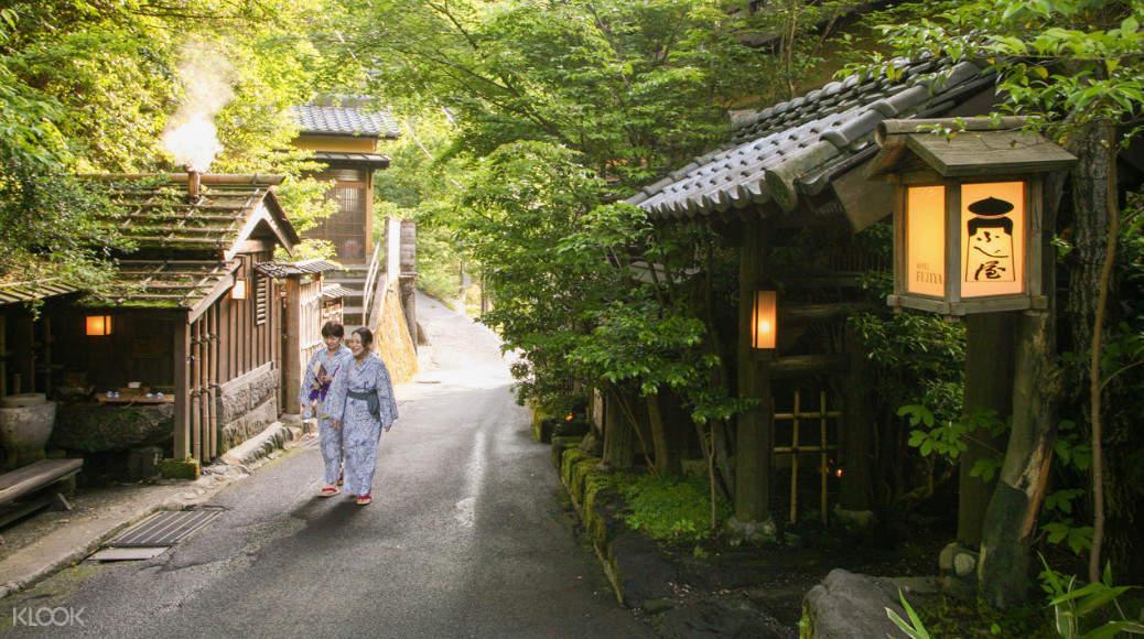 people walking in kurokawa onsen village