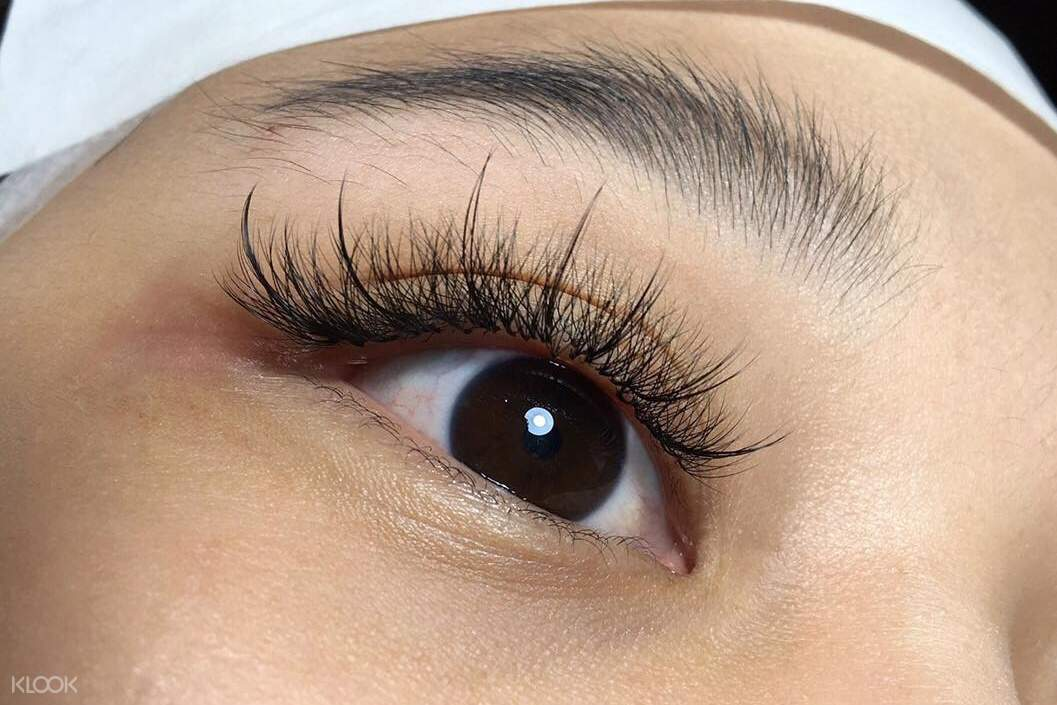 women with eyelash extensions