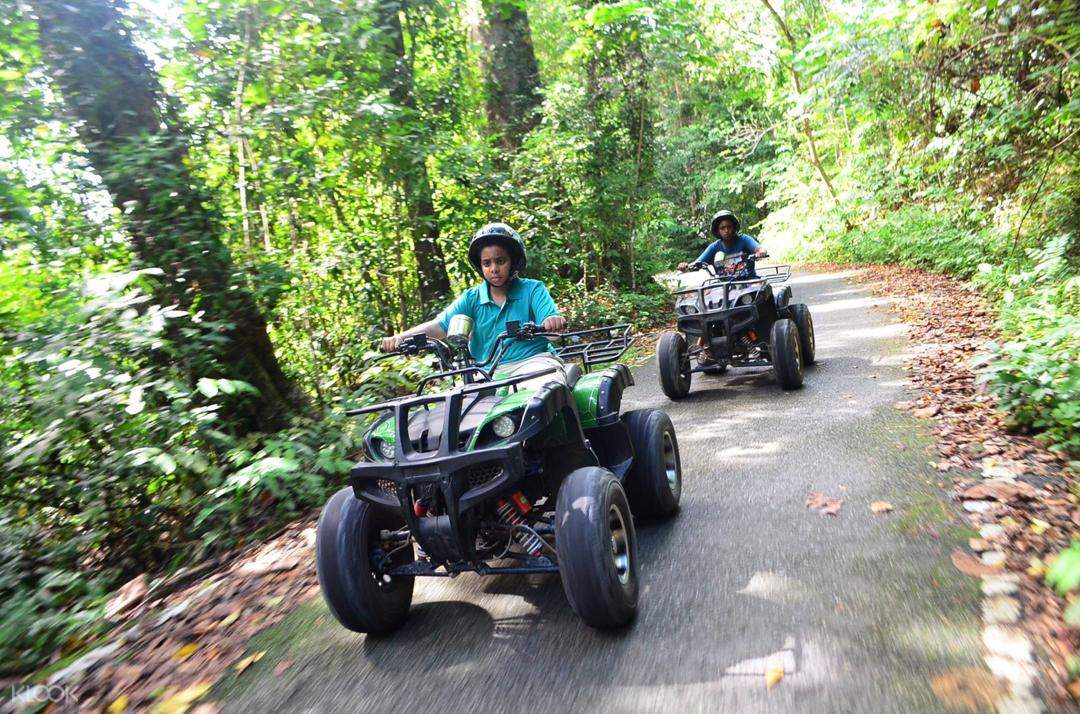tourist explore the forest with an atv in langkawi