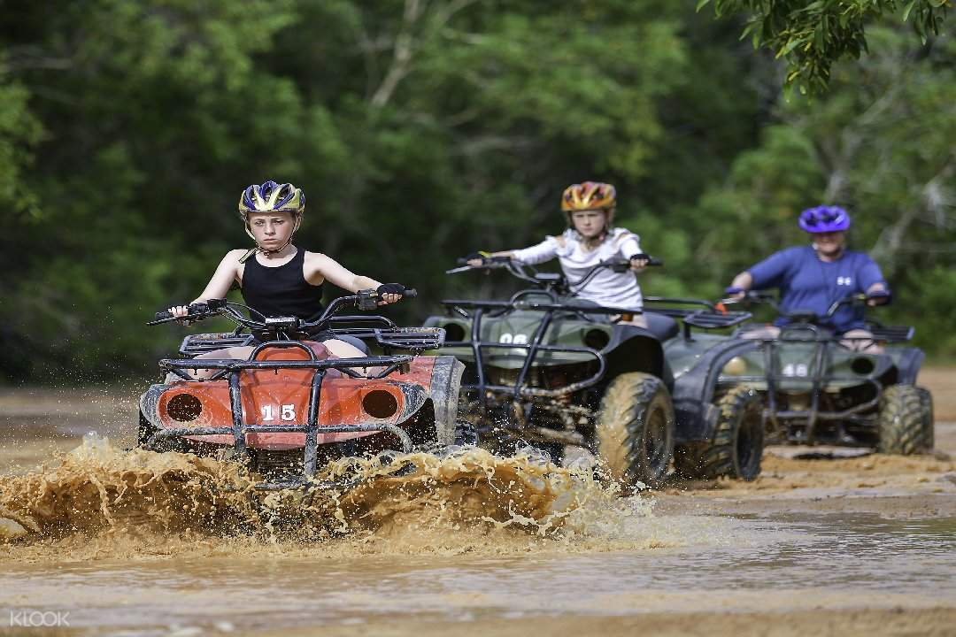 3 people riding ATV