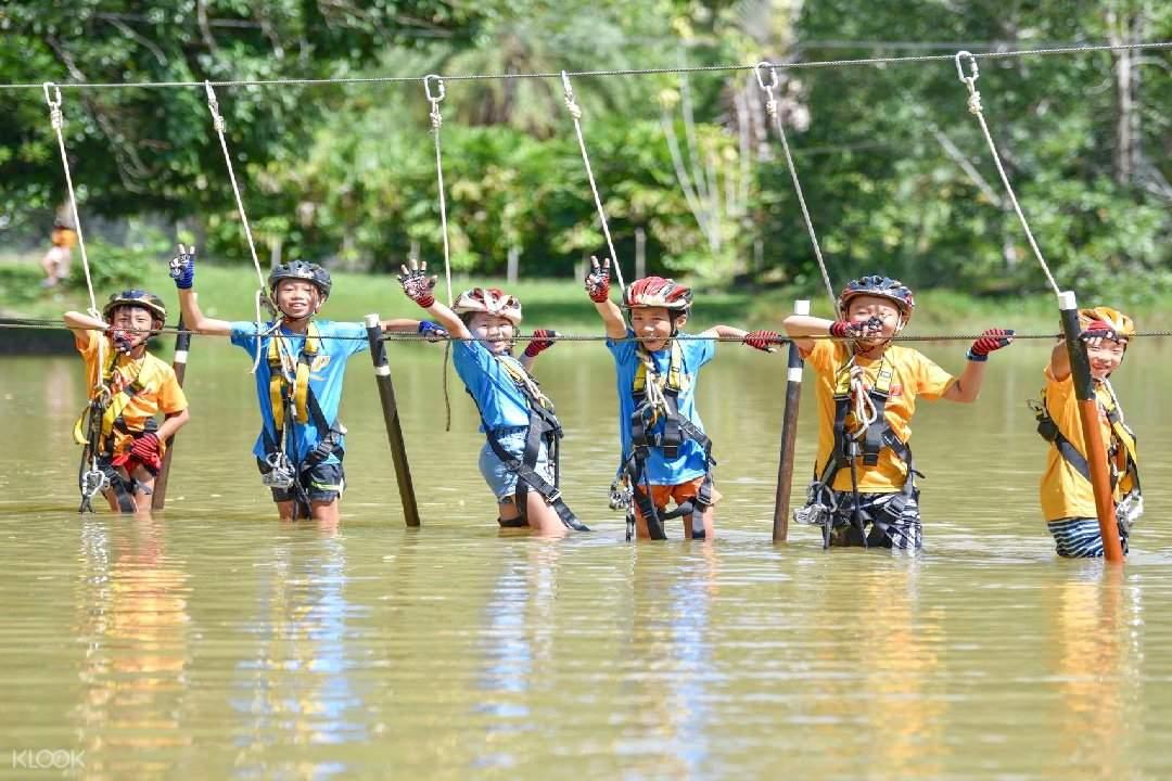 kids crossing a river