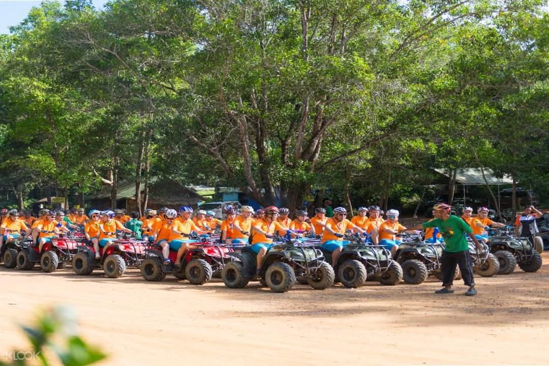 group of people riding ATV