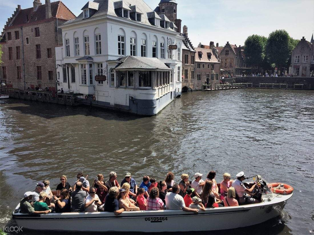 tour group of bruges canal cruise boat