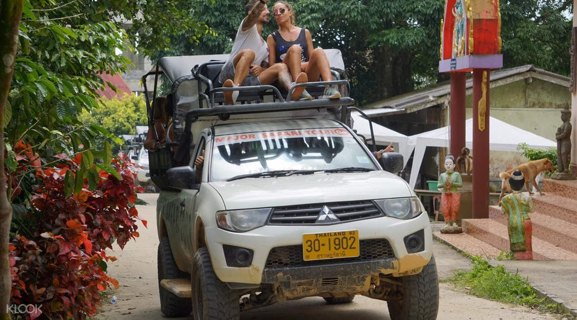 people riding a 4x4
