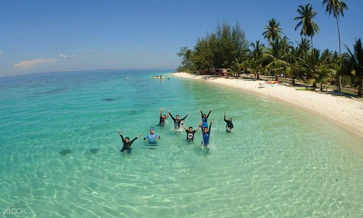 people swimming near Pulau Kentut