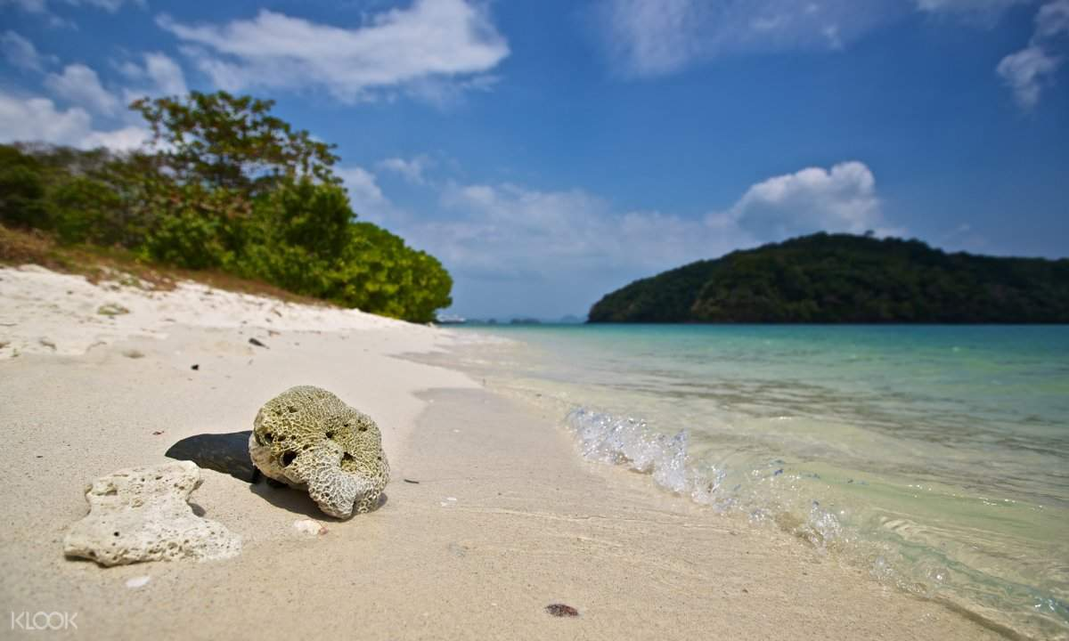 white beach of Pulau Kentut island