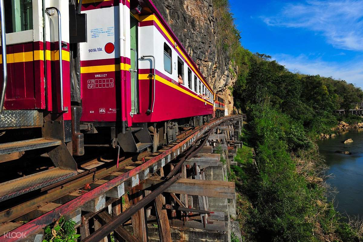 Observe the infamous Death Railway aboard an afternoon boat ride on River Kwai