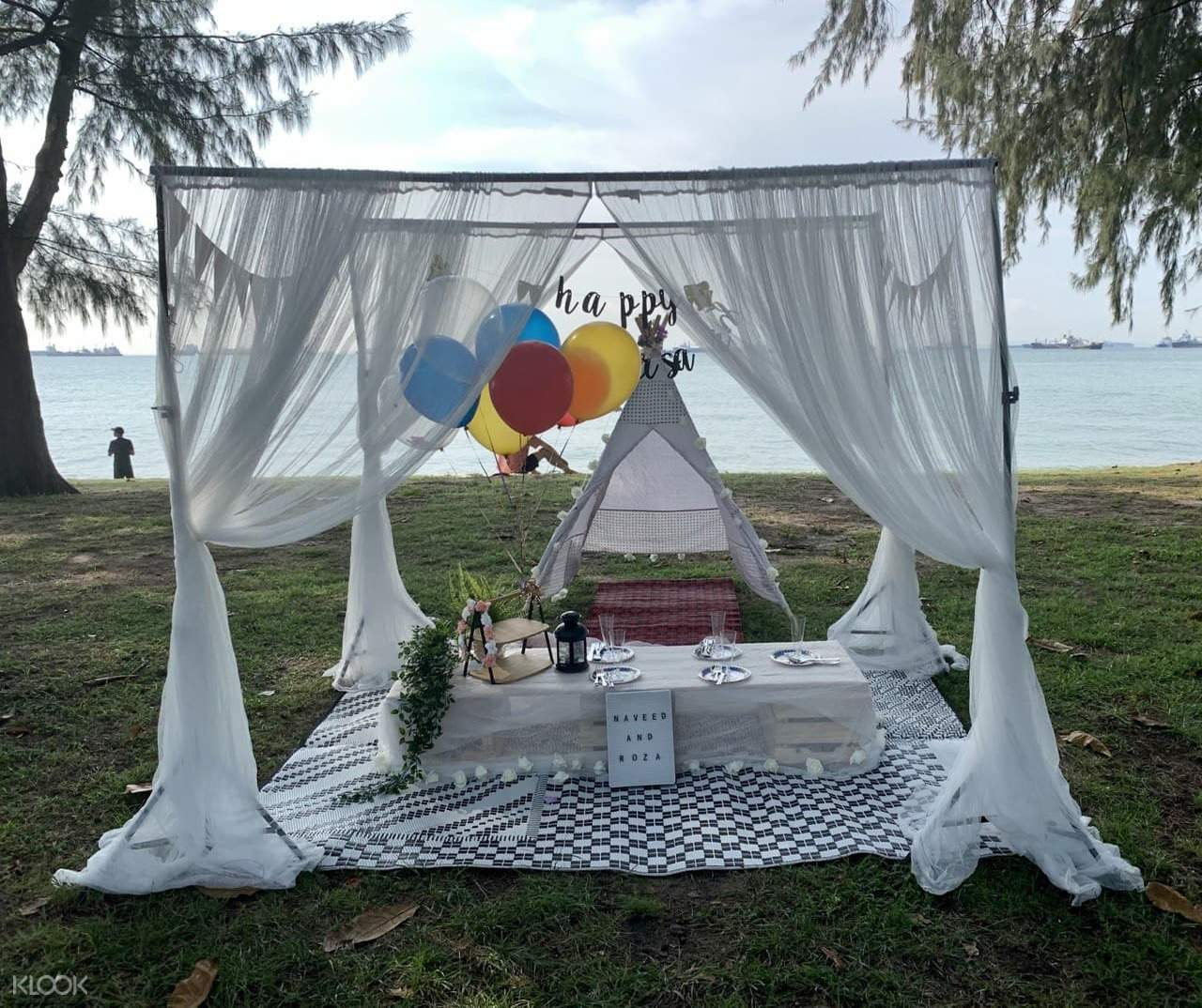 Picnic setup with teepee and lace standees