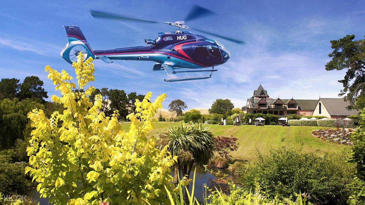a helicopter above the grass