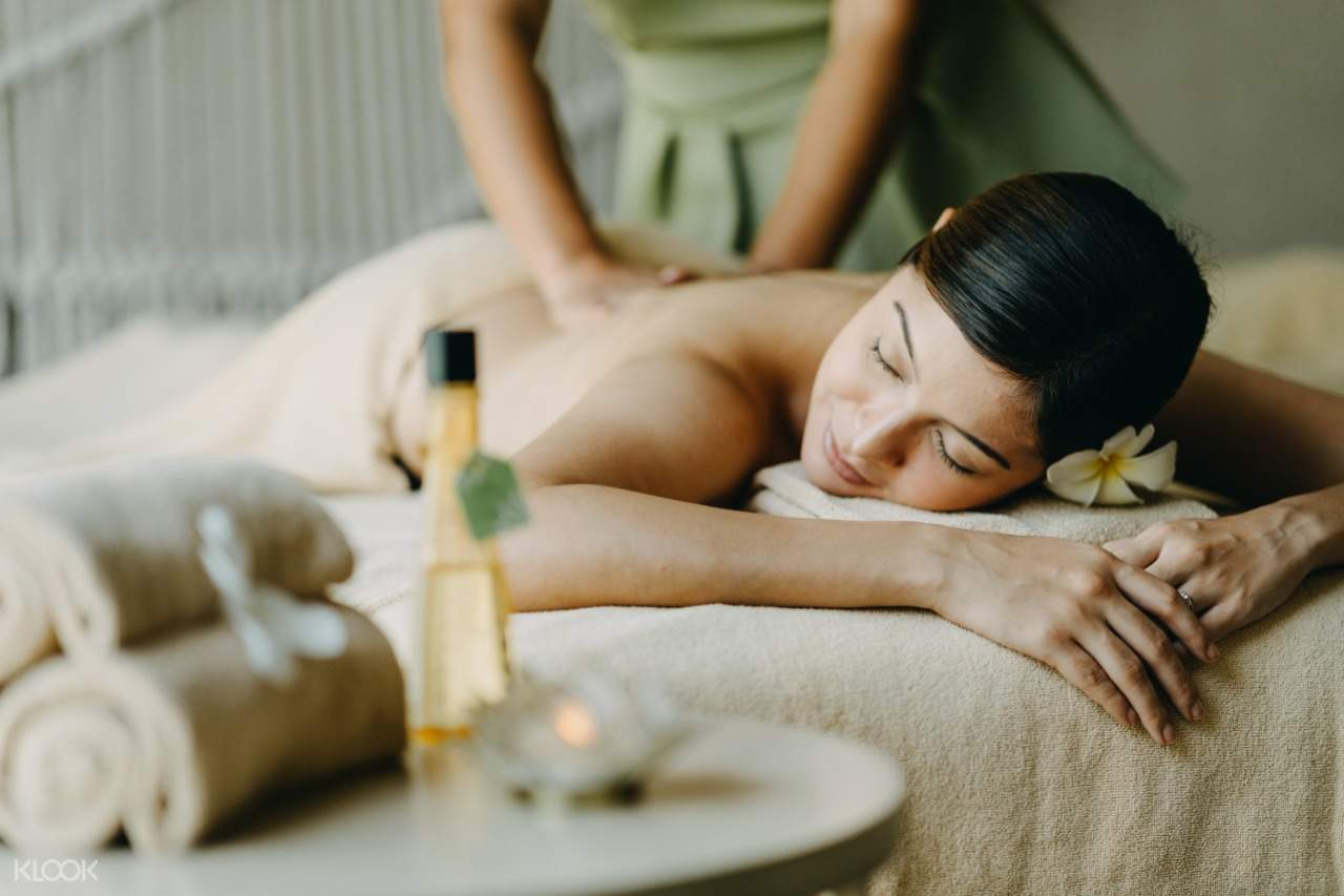 a woman getting a massage at Solea Mactan's spa