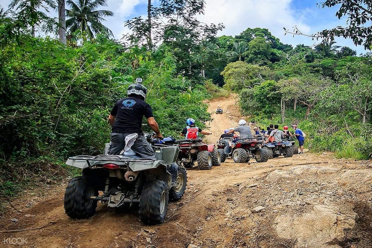 ATV riders in the jungle of Koh Samui