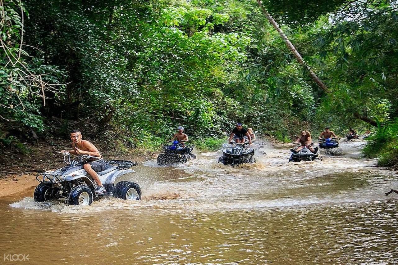 ATV rider splashing through swamps