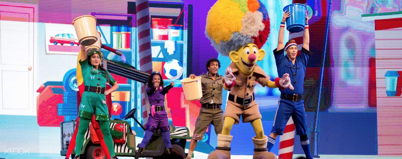 A musical show with singers and the global village mascot