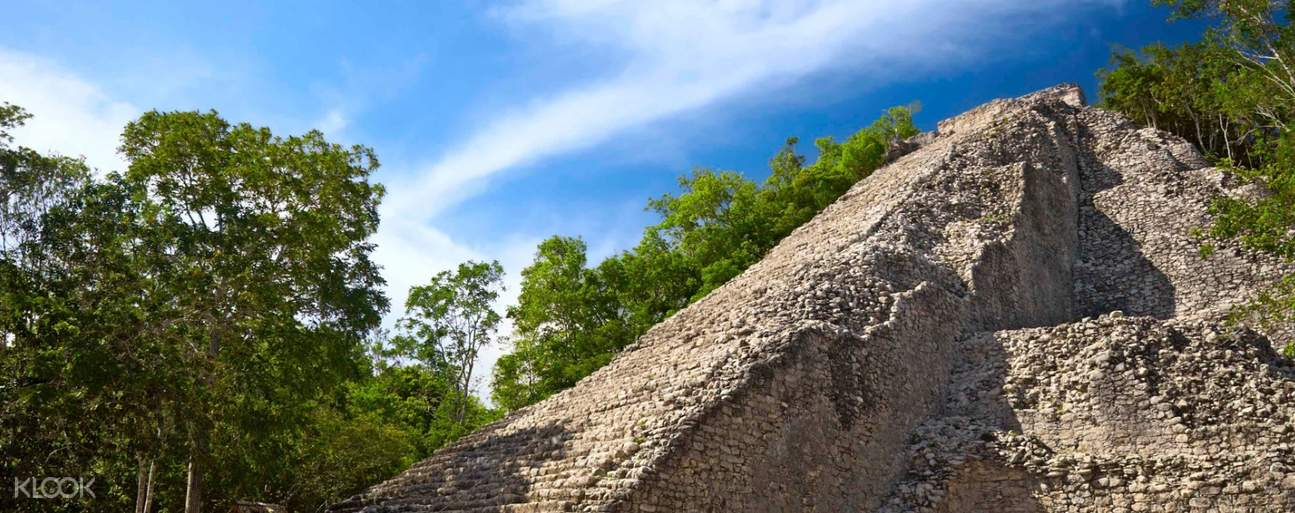 Ride a bicycle to Coba's pyramid