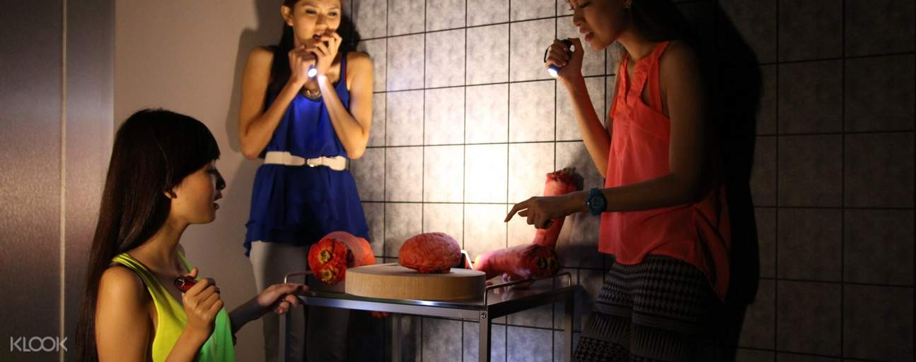 Women looking at brains on trays in Escape Room Kuala Lumpur