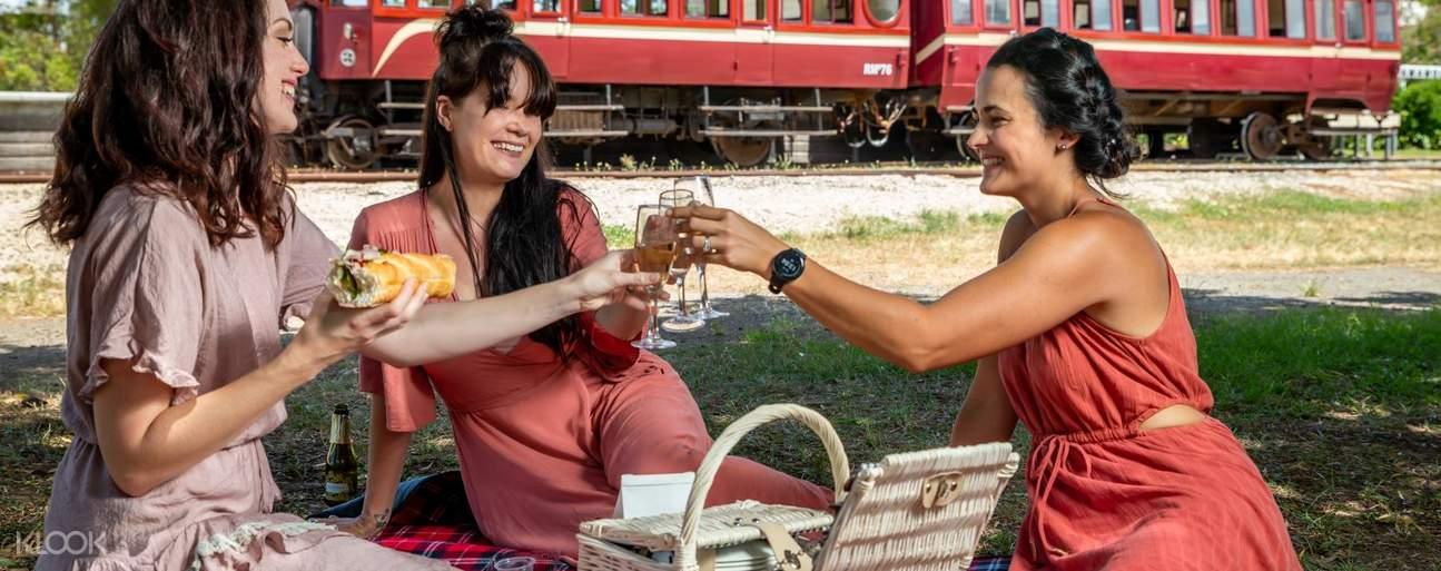 Women having a picnic near the Mary Valley Rattler Train