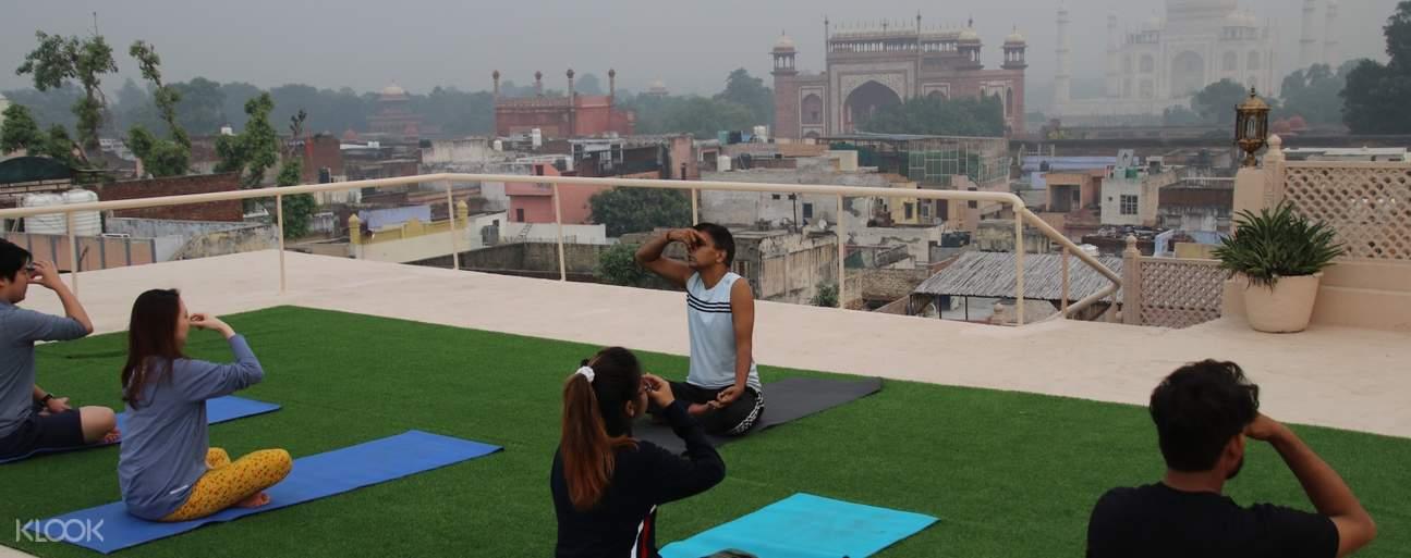 tourists doing yoga on rooftop