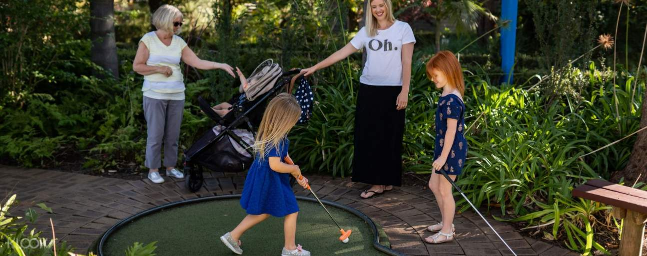 two women and two young girls playing mini golf at Wanneroo Botanic Gardens