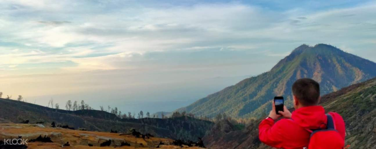 Enjoy the beautiful sunrise after your hike to top of Ijen