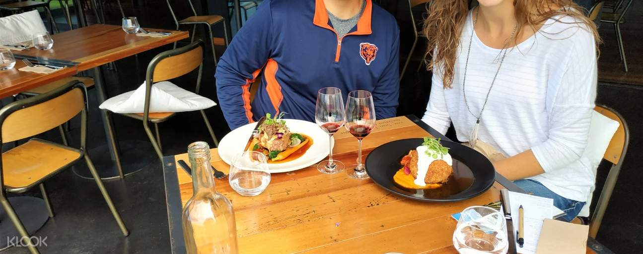 couple eating in winery in marlborough