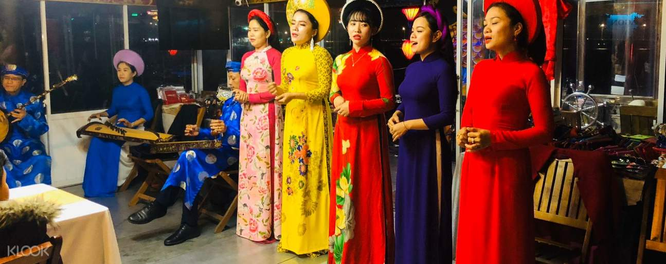 Performers during traditional Hue music show on Huong River
