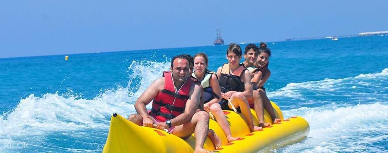 people on banana boat ride