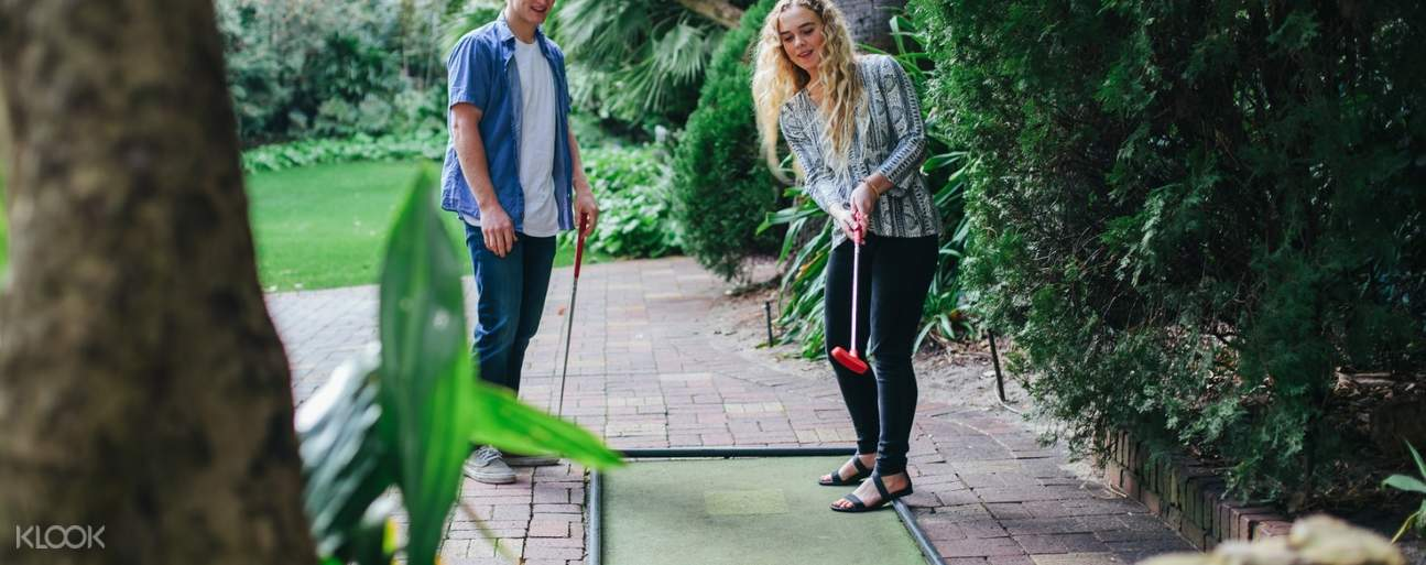 man and woman playing mini golf at Wanneroo Botanic Gardens