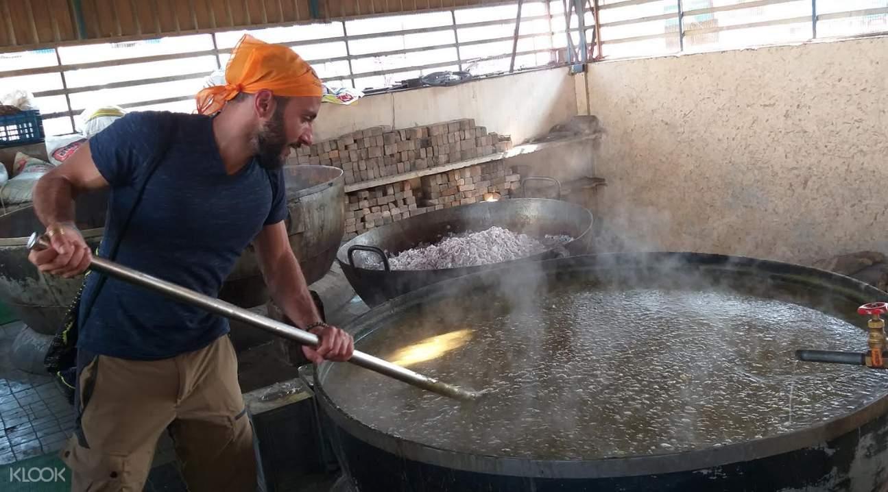 man cooking at the langar