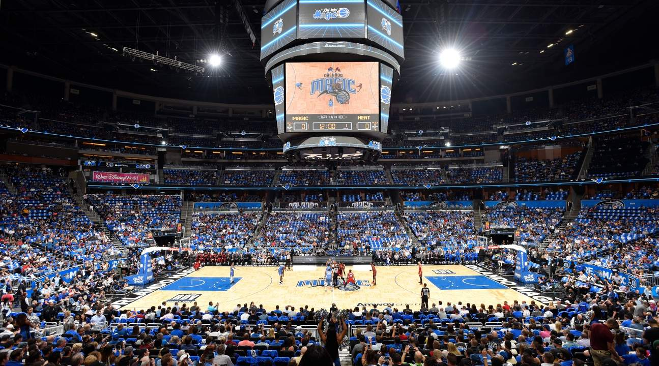Orlando Magic competing with another team in the Amway Stadium