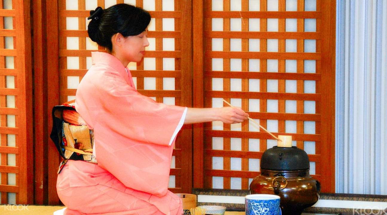 Japanese tea host during tea ceremony