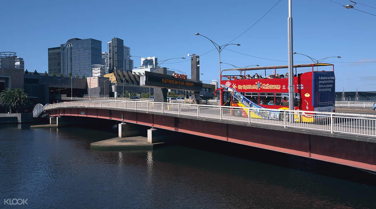 sightseeing bus on bridge