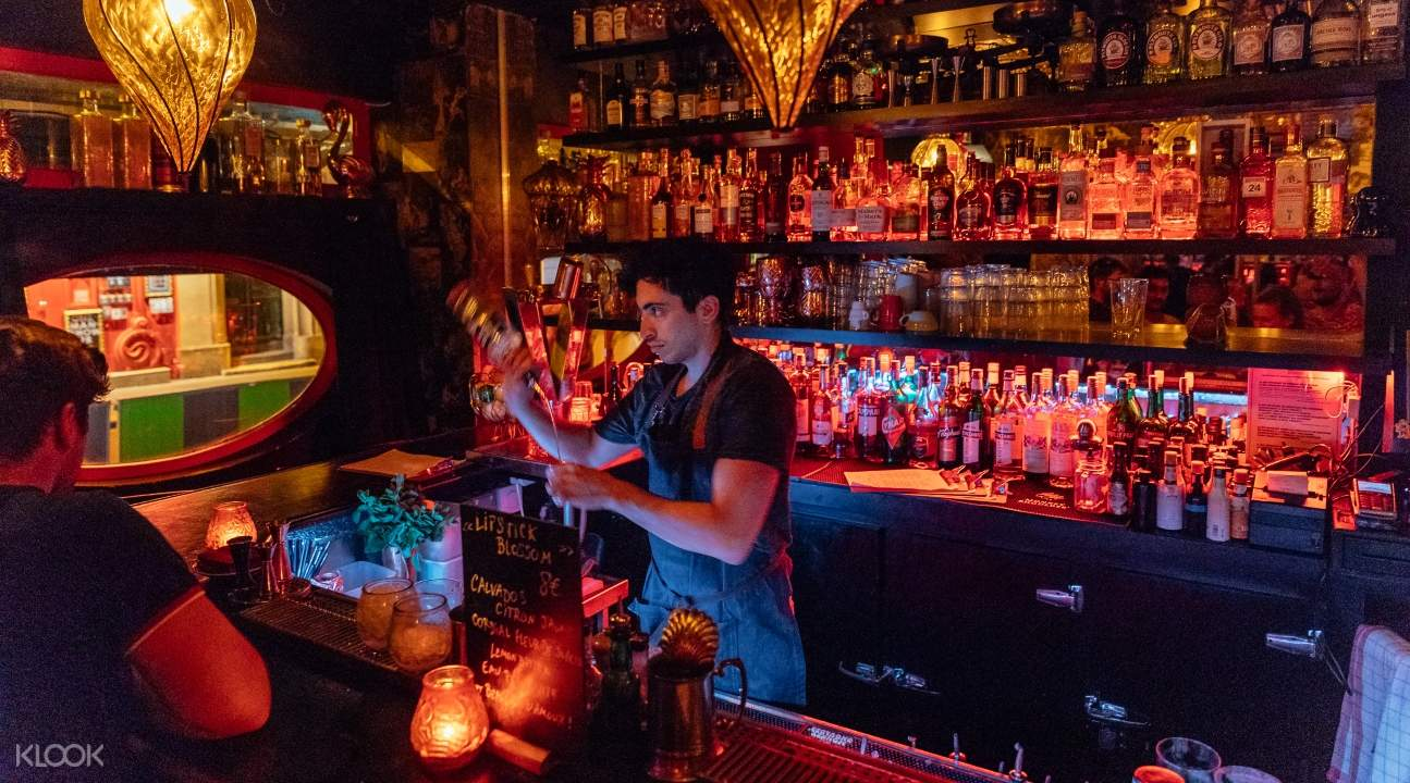a bartender mixing drinks