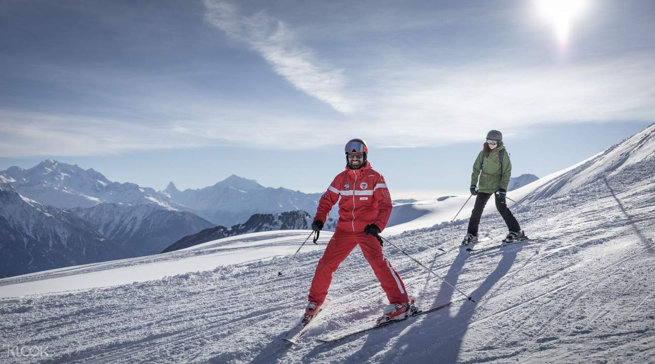 two people skiing around the Aletsch Arena