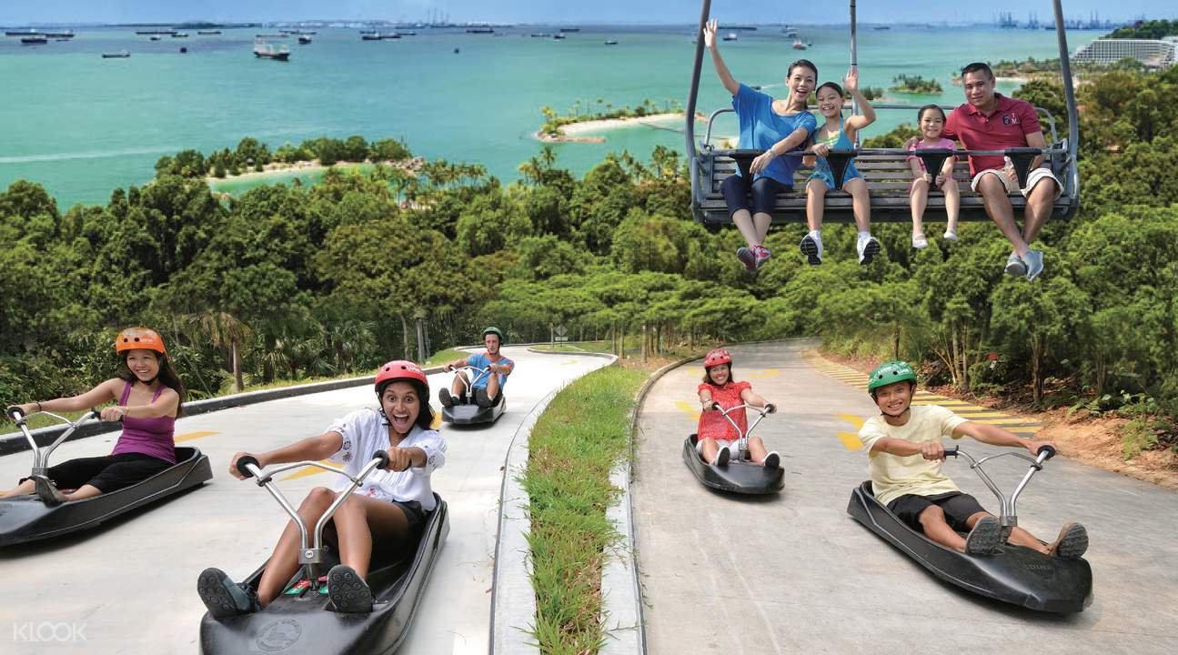 people riding the luge