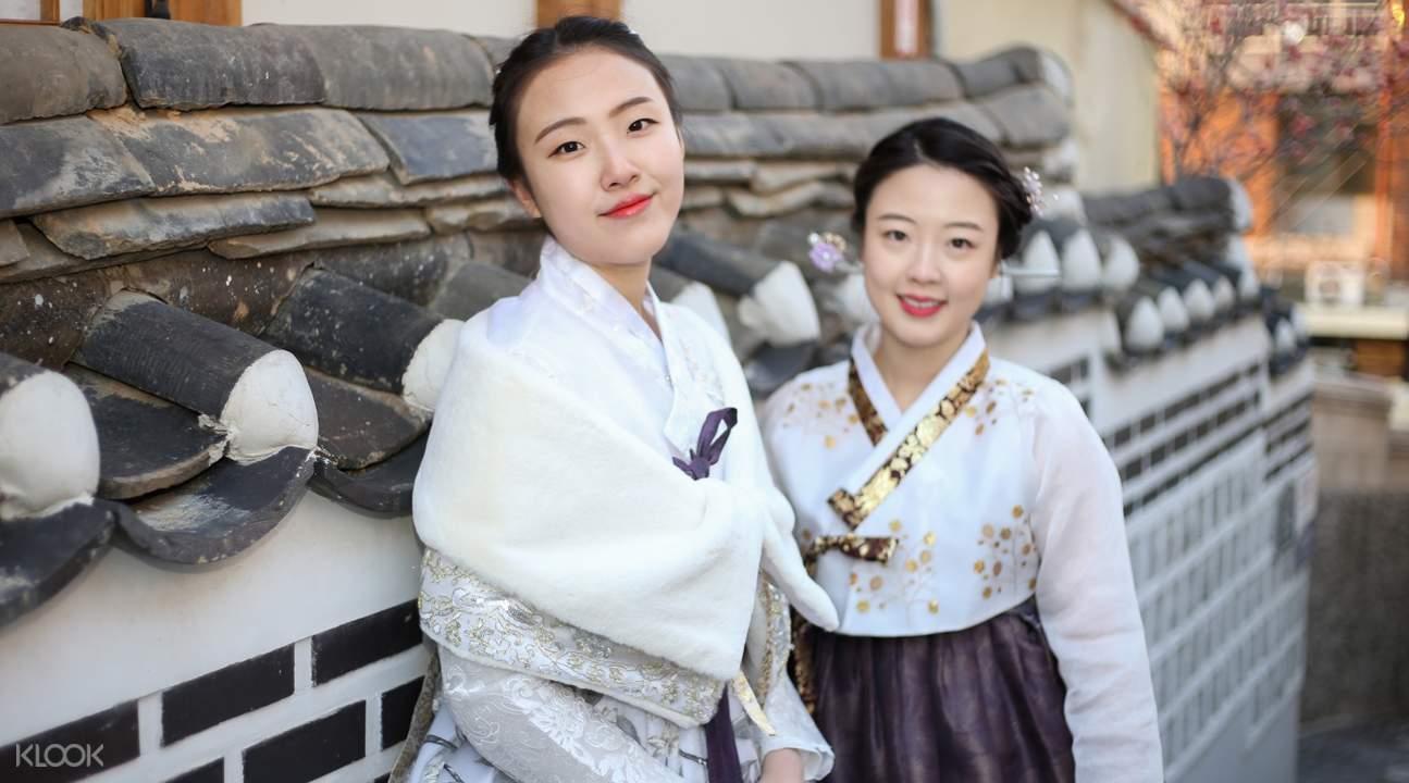 two girls posing in hanboks